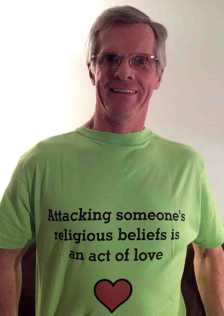 Darwin Bedford wearing his shirt that says 'Attacking someone's religious beliefs is an act of love'