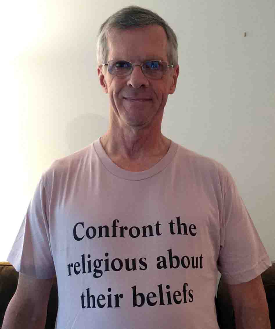 Darwin Bedford wearing his shirt that says 'Confront the religious about their beliefs'