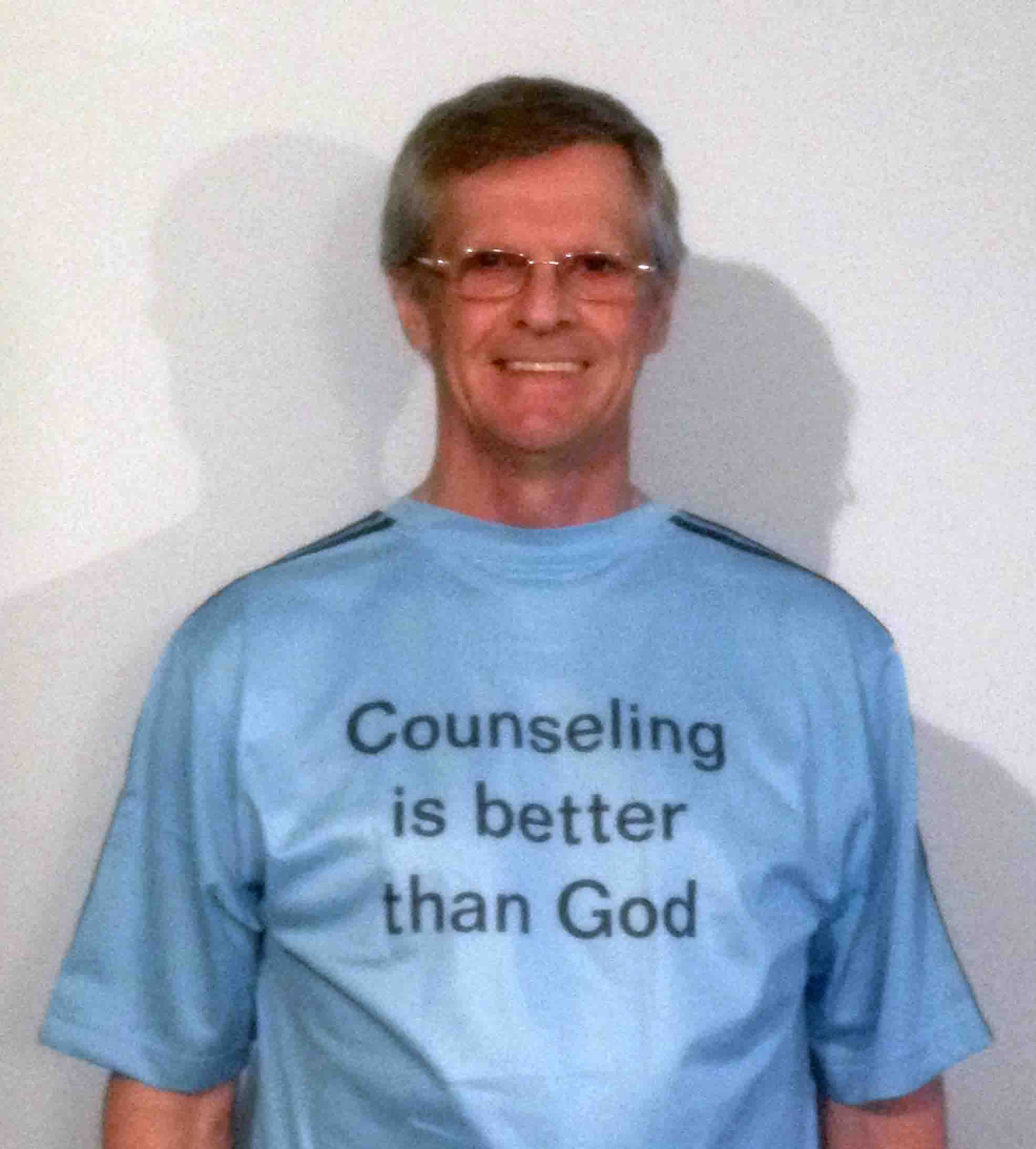 Darwin Bedford wearing his shirt that says 'Counseling is better than God'