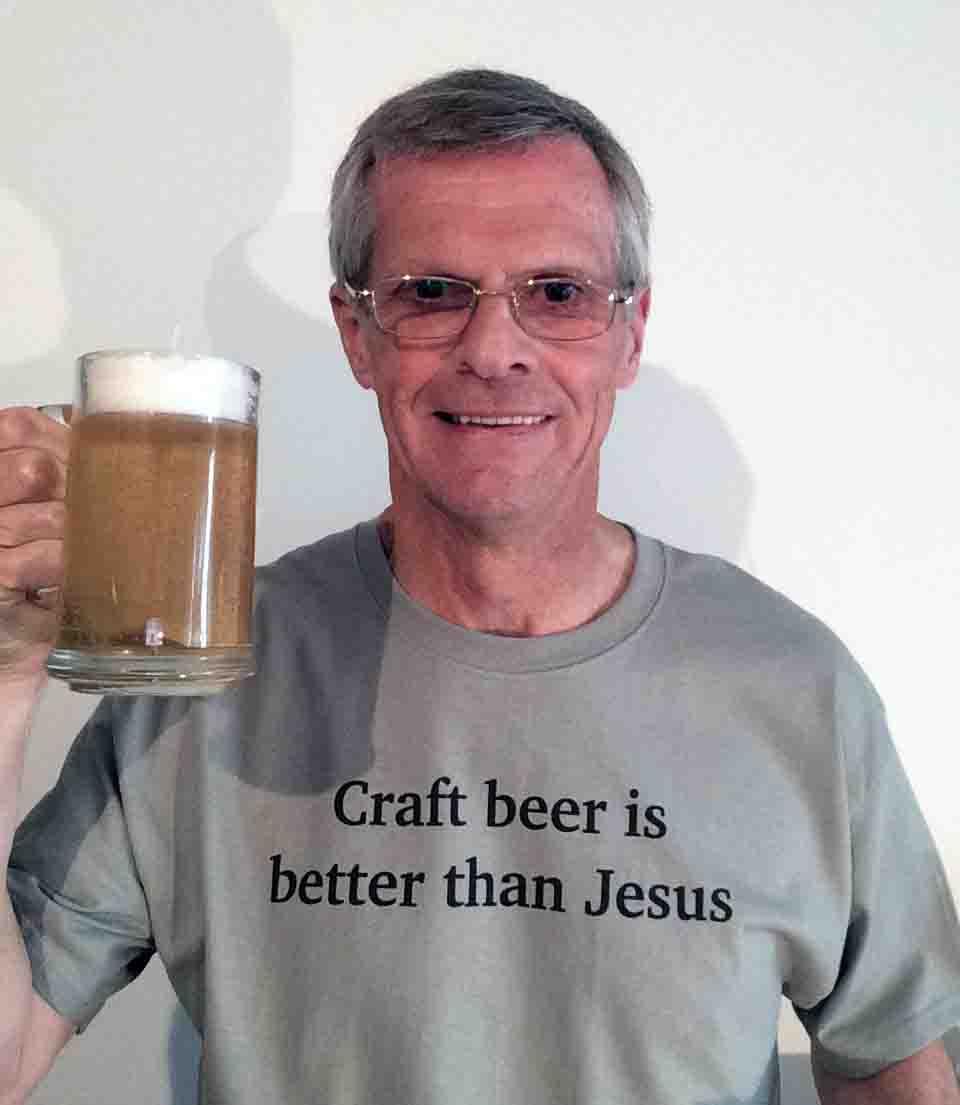 Darwin Bedford wearing his shirt that craft beer is better than Jesus