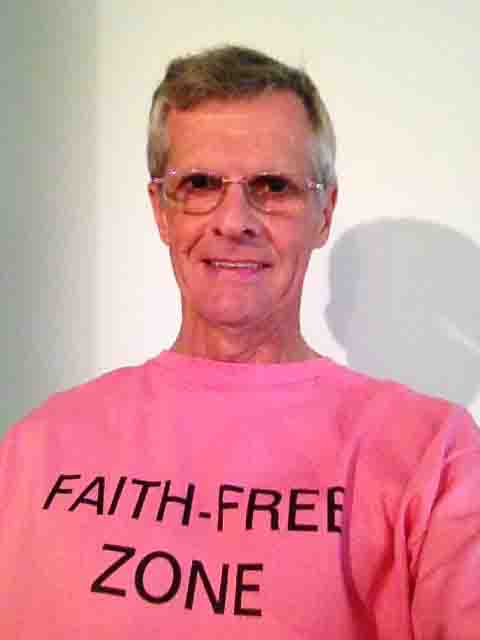 Darwin Bedford wearing his shirt that says 'Faith-free Zone'