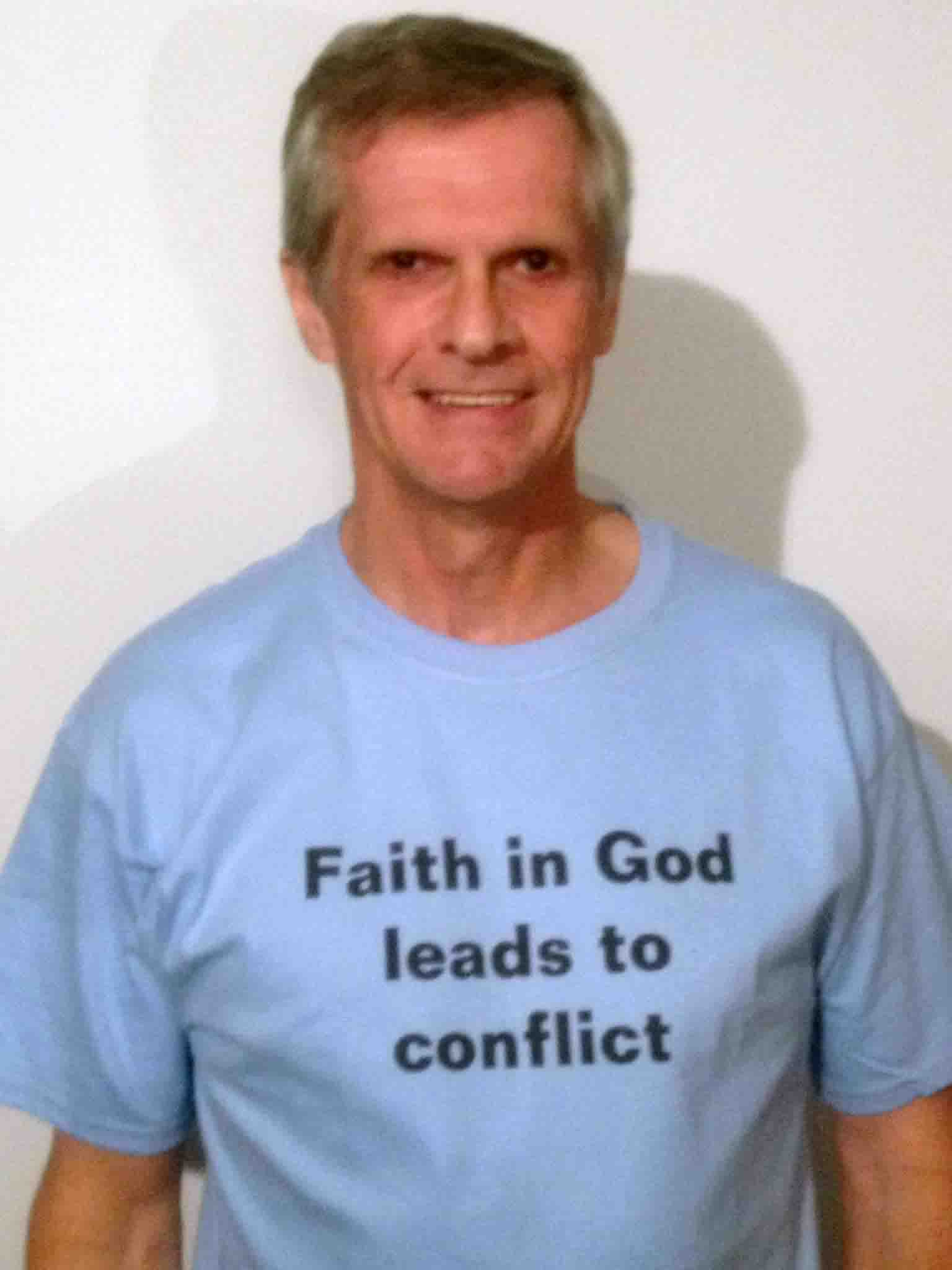Darwin Bedford wearing his shirt that says 'Faith in God leads to conflict'