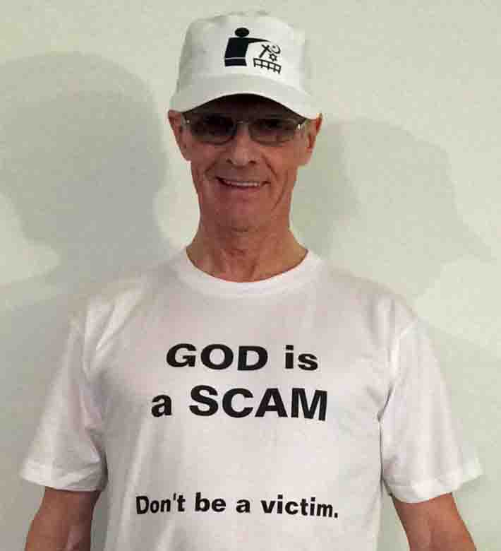 Darwin Bedford wearing his shirt that says 'GOD is a SCAM - Don't be a victim'