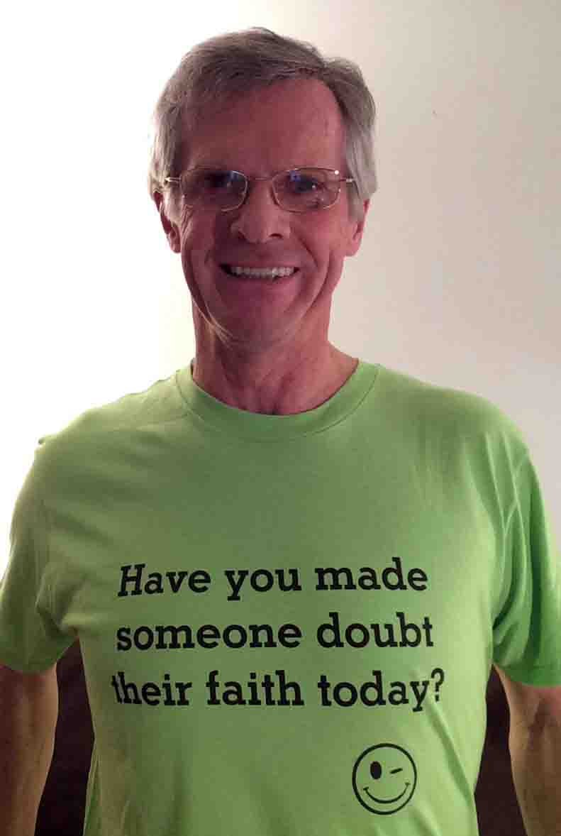 Darwin Bedford wearing his shirt that asks 'Have you made someone doubt their faith today'