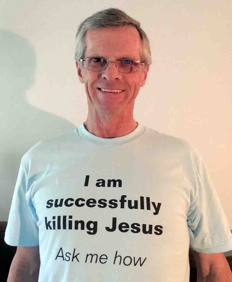 Darwin Bedford wearing his shirt that says 'I am successully killing Jesus; ask me how'