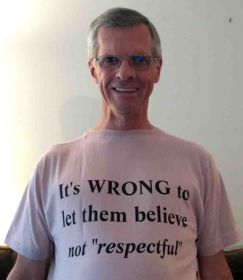 Darwin Bedford wearing his shirt that says 'It is WRONG to let them believe(not respectful)'