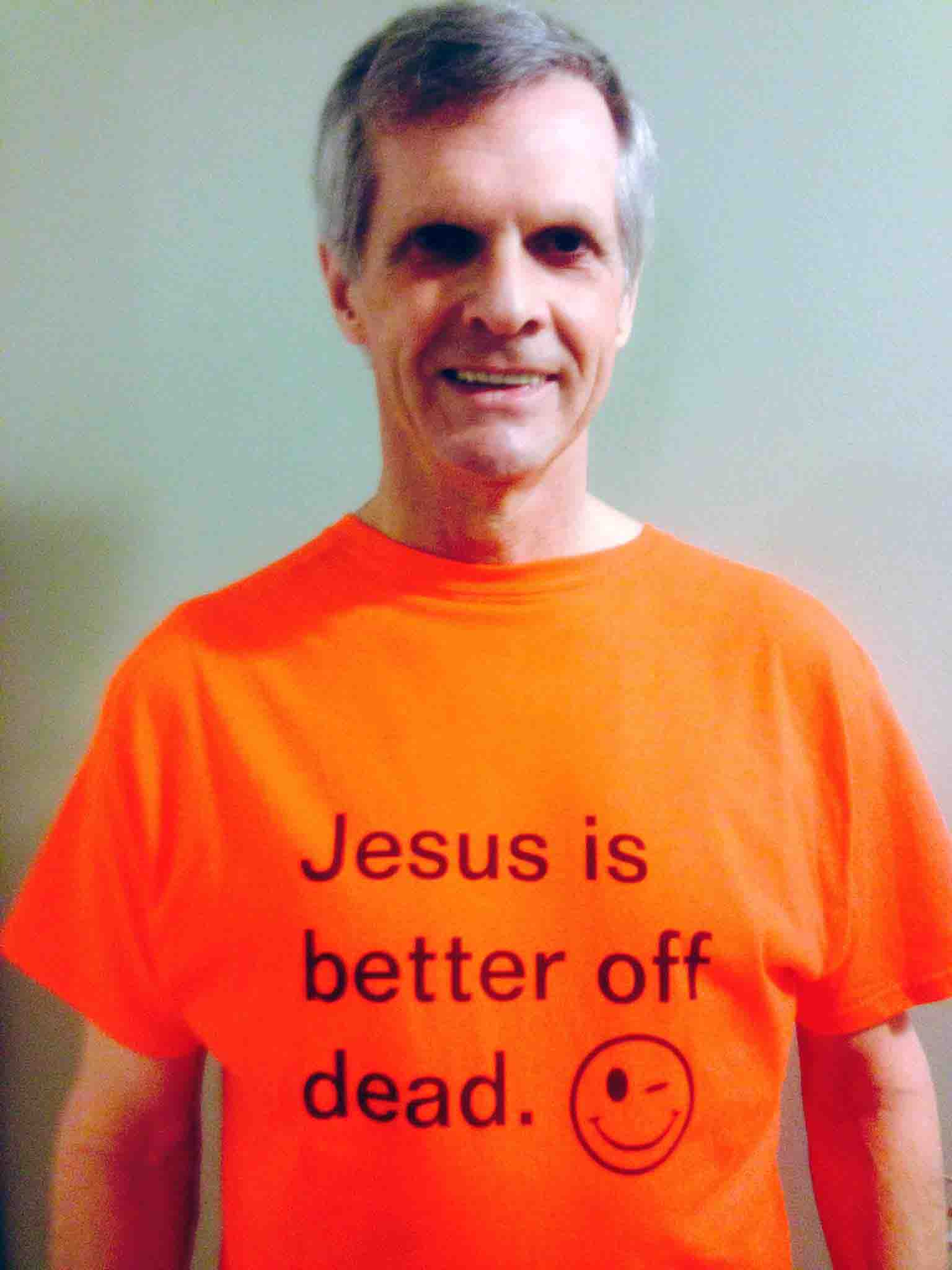 Darwin Bedford wearing his shirt that says 'Jesus is better off dead'