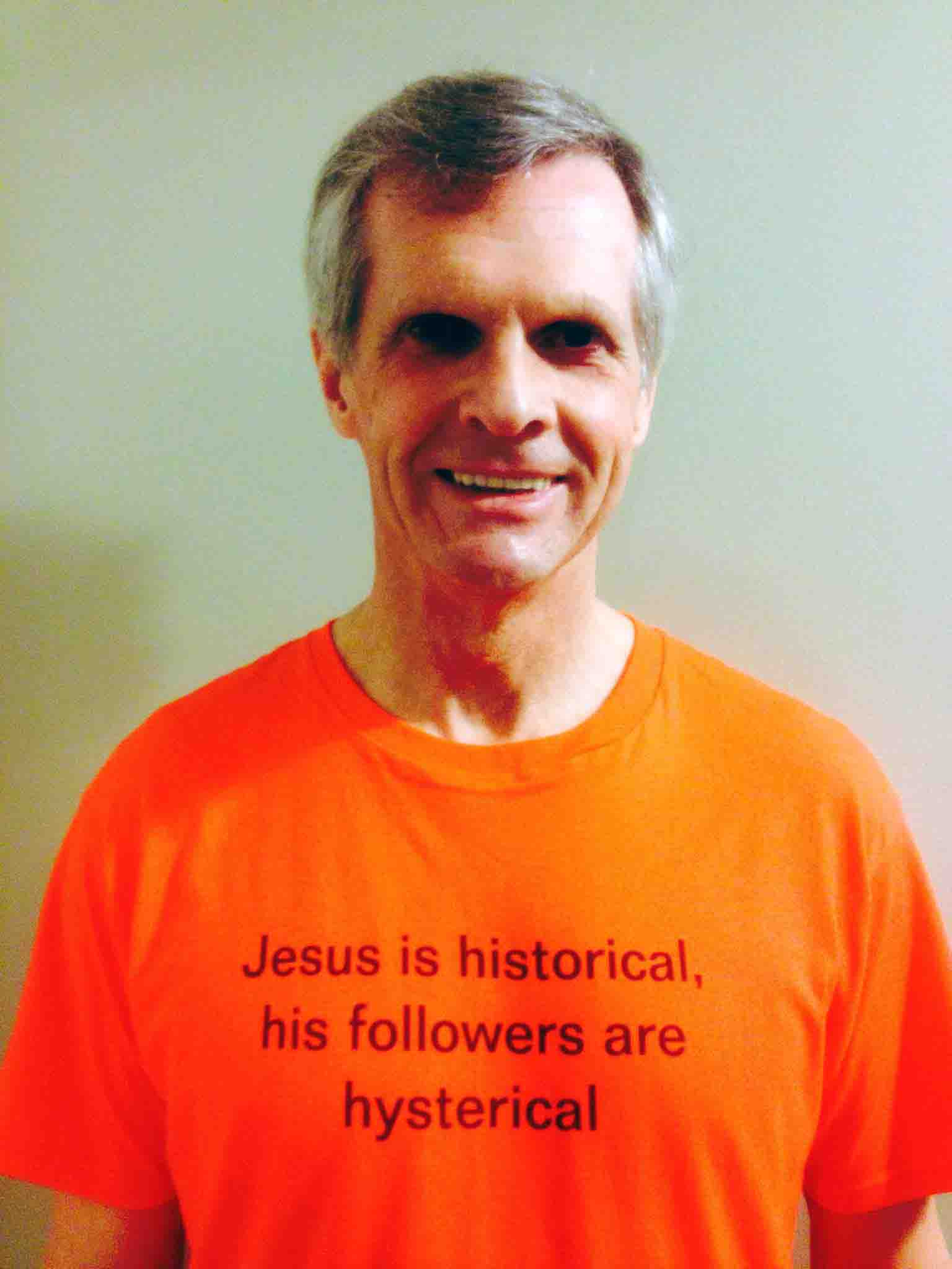 Darwin Bedford wearing his shirt that says 'Jesus is historical His followers are hysterical'