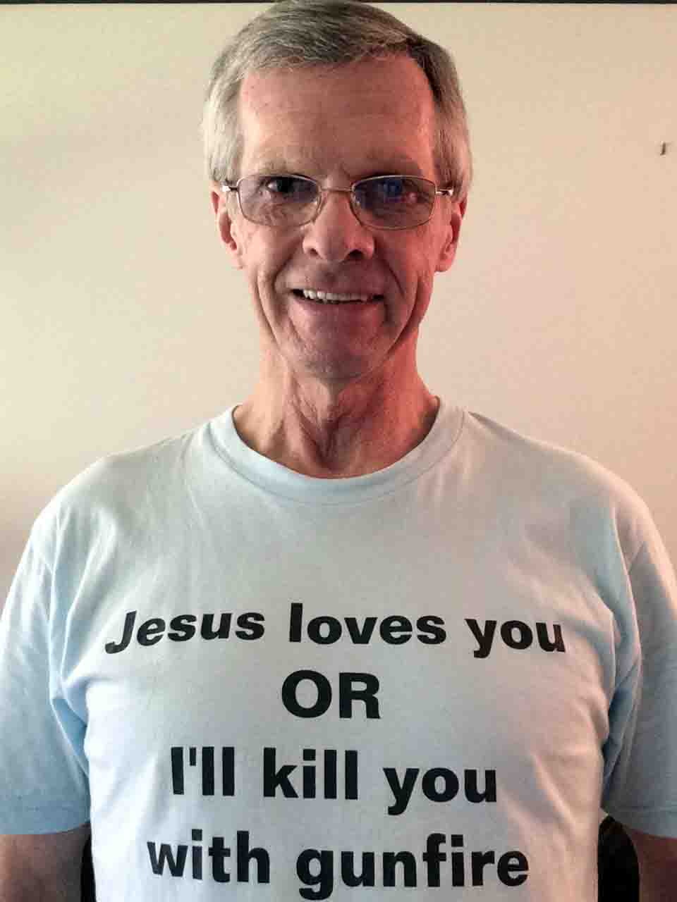Darwin Bedford wearing his shirt that says 'Jesus loves you OR I will kill you with gunfire'