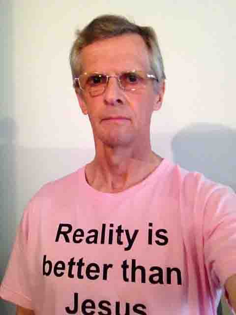 Darwin Bedford wearing his shirt that says 'Reality is better than Jesus'