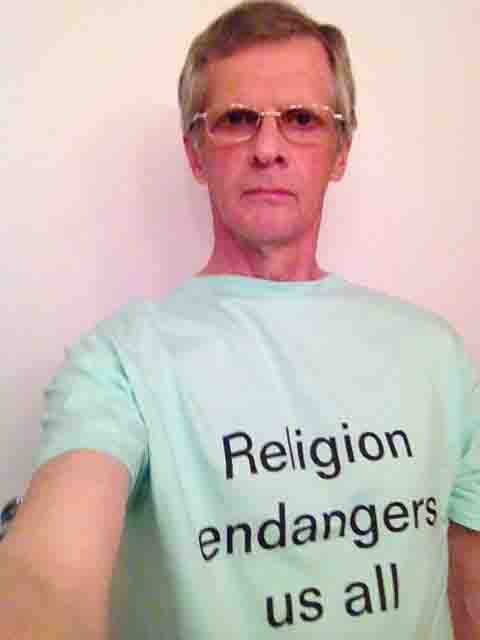 Darwin Bedford wearing his shirt that says 'Religion endangers us all'