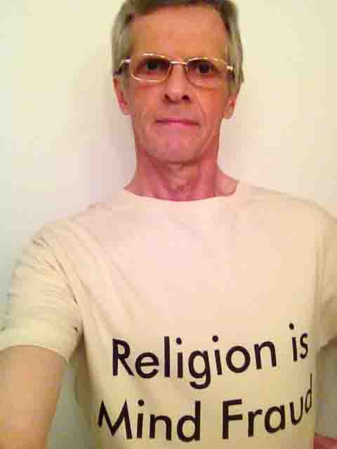Darwin Bedford wearing his shirt that says 'Religion is mind fraud'