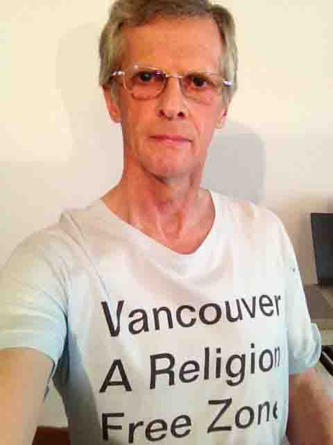 Darwin Bedford wearing his shirt that says 'Vancouver, a religion-free zone'