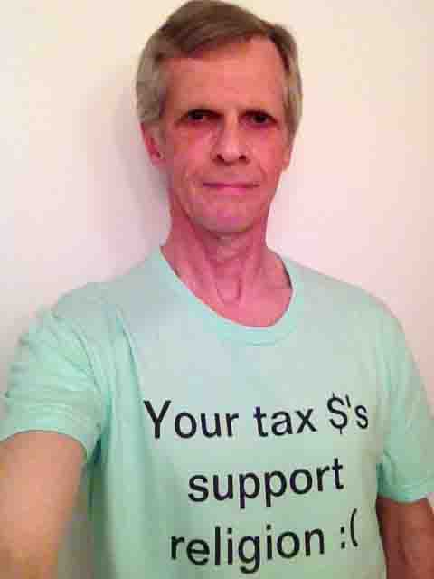 Darwin Bedford wearing his shirt that says 'Your tax $'s support religion :('