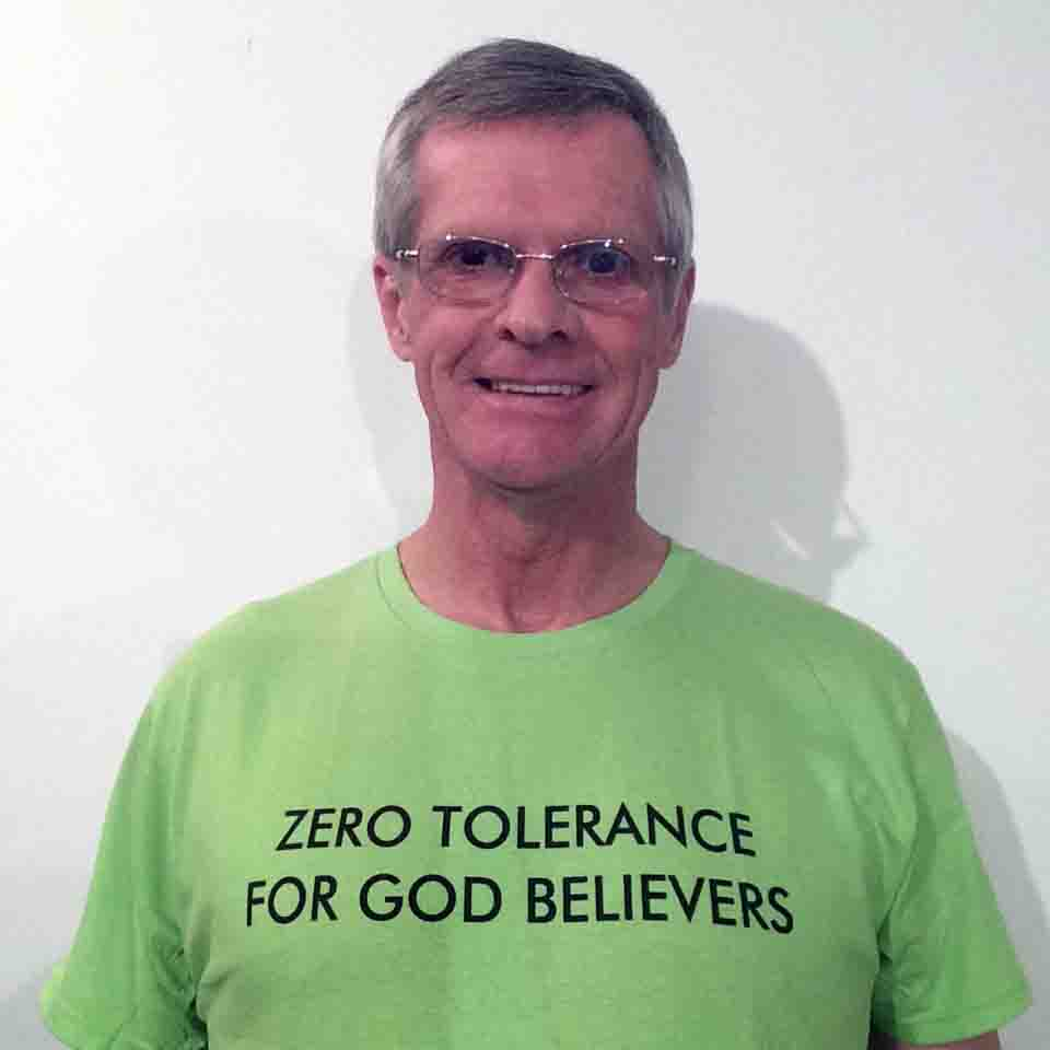 Darwin Bedford wearing his shirt that says 'Zero tolerance for God believers'