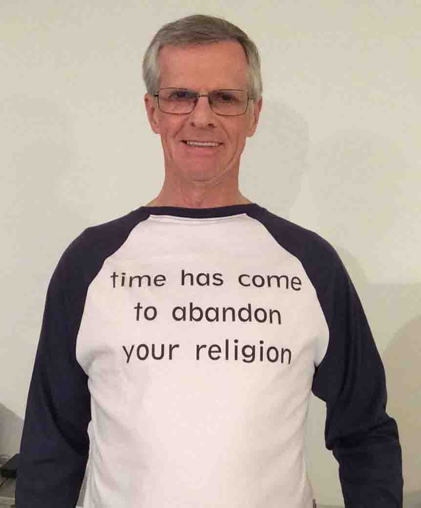 Darwin Bedford wearing his shirt that says 'time has come to abandon your religion'