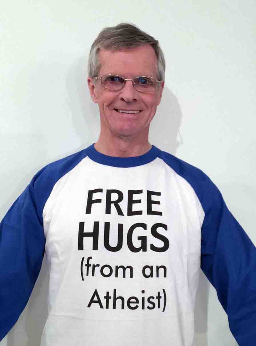 Darwin Bedford wearing his shirt that says 'FREE HUGS from an atheist'