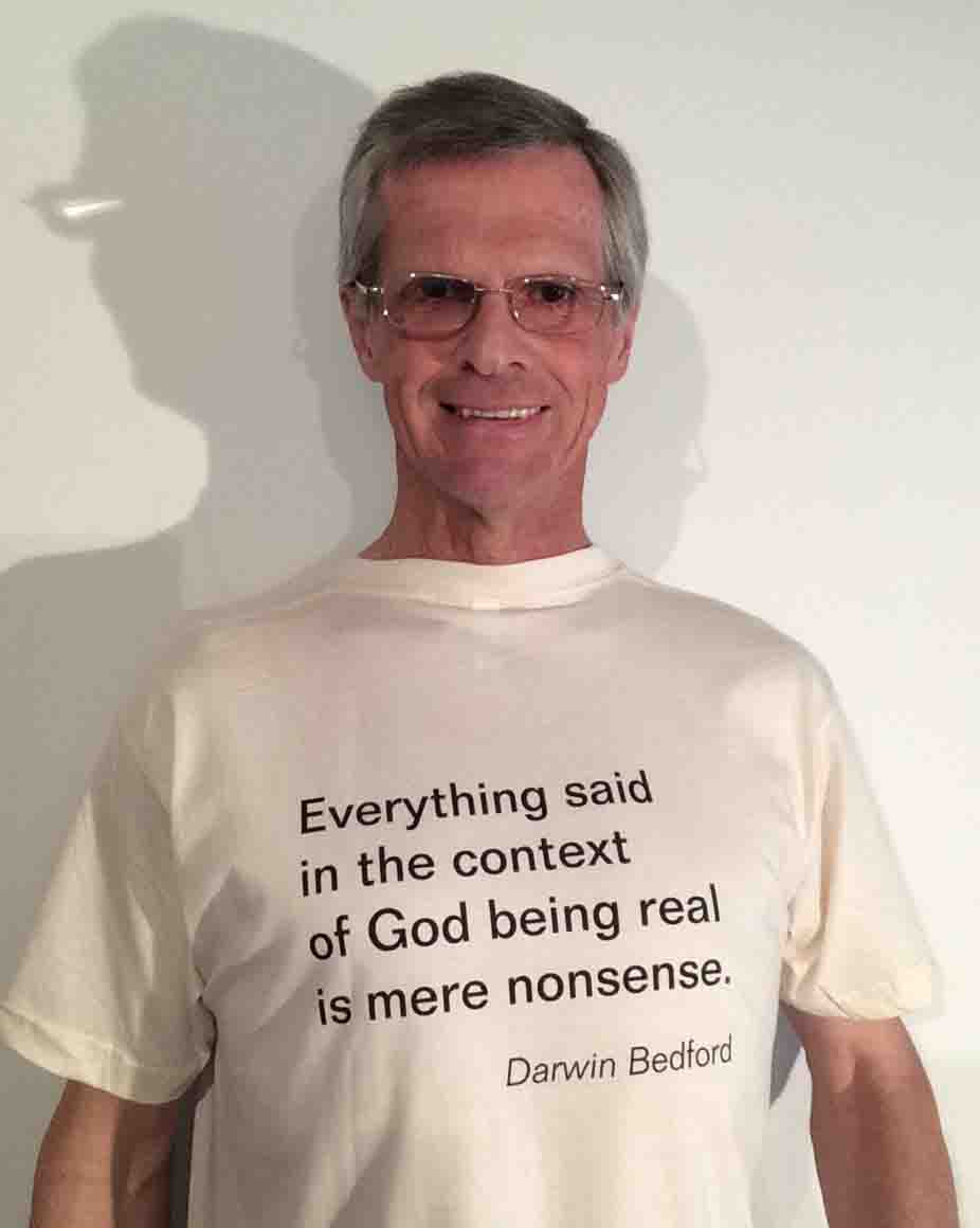 Darwin Bedford wearing his shirt that says 'Everything said in the context of God being real is mere nonsense'