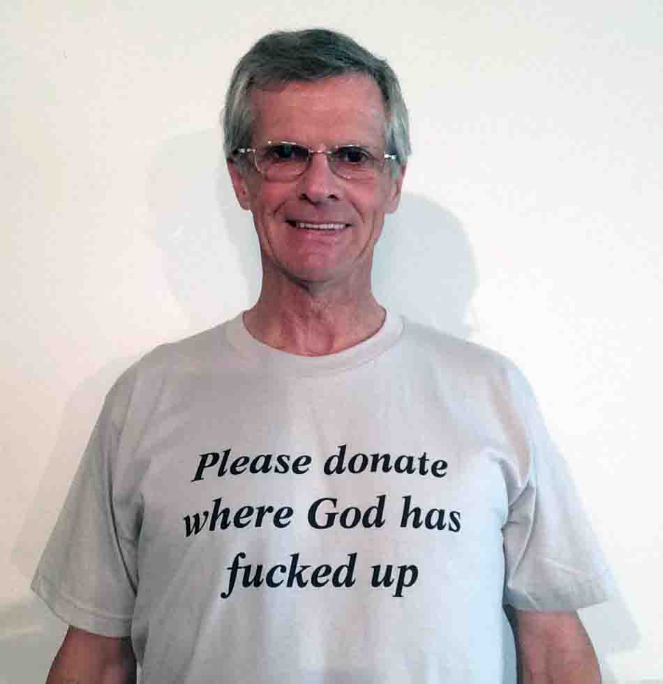 Darwin Bedford wearing his shirt that says 'Please donate where God has fucked-up'
